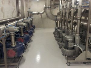 Central vacuum station with two different types of pumps
