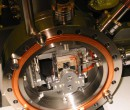 Assembling of vacuum components in vacuum chamber
